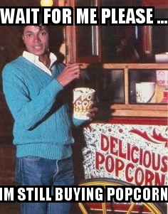 Michael Jackson Buying Popcorn with the caption WAIT for me please ... IM STILL BUYING POPCORN