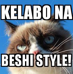 Angry Cat with the caption kelabo na beshi style!